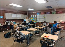 Students learn about ag business from Sidnee Hill.