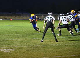 Simpson carries the ball against the Hansen Huskies