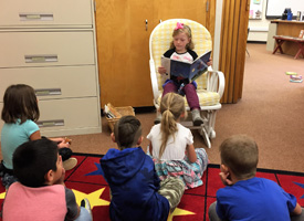 Lucy is a guest reader in 1st grade