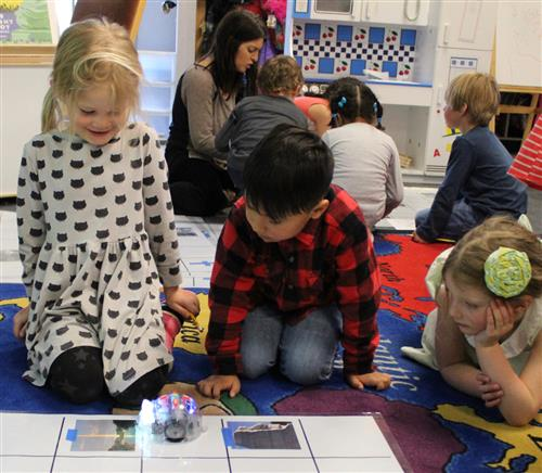 "Kindergarteners with ""B-bots"" robots"