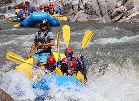 students and guide rafting