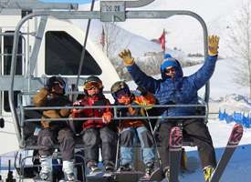 Students and teacher on chair lift