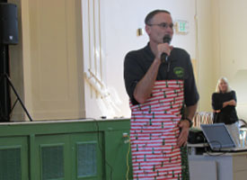 PTA Kicks off wrapping paper fundraiser by wrapping up Mr. Biggers as a roll of paper.