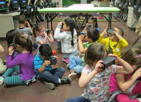 Pre-School students using VR glasses.