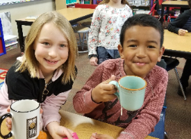 Students drink out real cups to reduce waste.