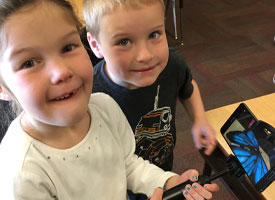 Kindergarten students experiencing Google Expeditions AR Pioneer Program