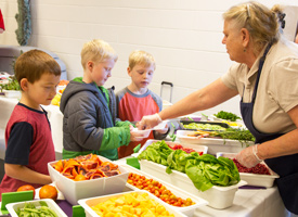 photo of children choosing food at school lunch