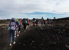 students hiking through Craters of the Moon