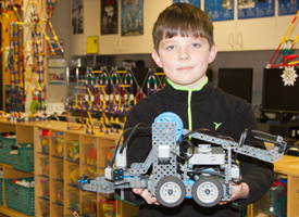 Bellevue Elementary Student holding a robot