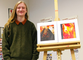 Wood River High School student standing next to his artwork
