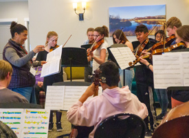 Ellen Sanders with High School orchestra students playing at Silver Creek Living