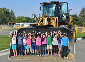 Carey Students with a loader