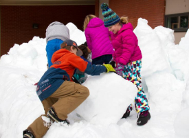 students building snow forts