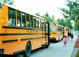 photo of students boarding buses at school
