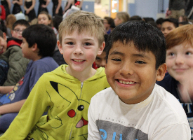 two elementary students smiling at camera