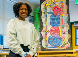 Wood River High School Student standing next to her artwork