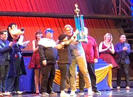 Music department in Disneyland winning a trophy