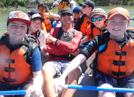 students and teacher rafting