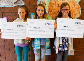 3 Hailey Elementary Students holding up PBS kids writers contest awards.