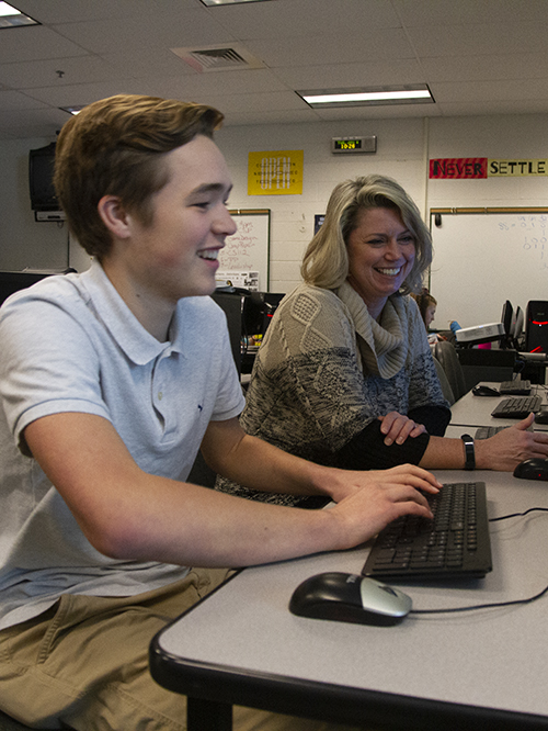 Becky Duncan helping at student at a computer