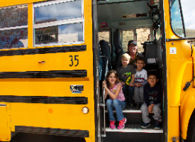 students and bus driver on school bus