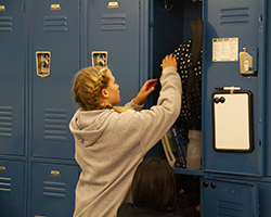 student using locker