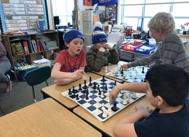 students playing chess in a classroom