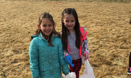 two girls with plastic bags