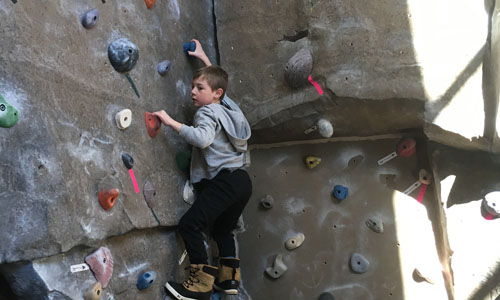 boy climbing wall at the YMCA