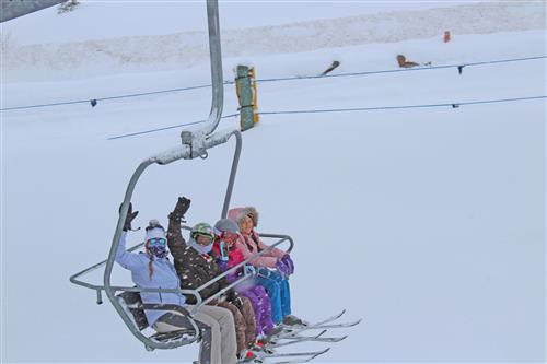 students on ski lift